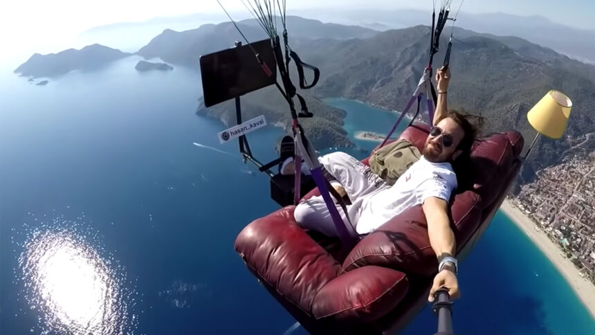 paraglider watching tv on his sofa